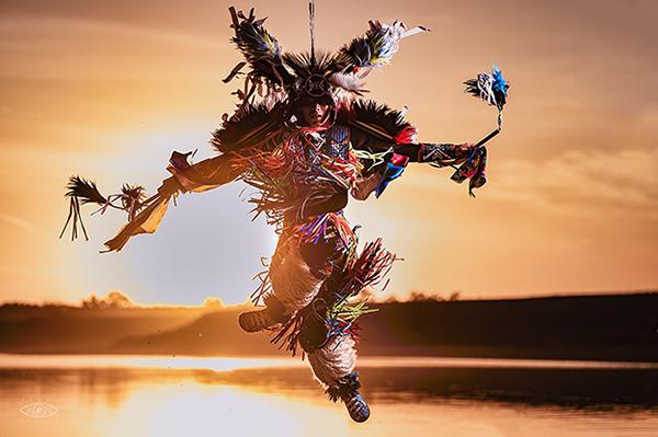 Tribal dancer at sunset
